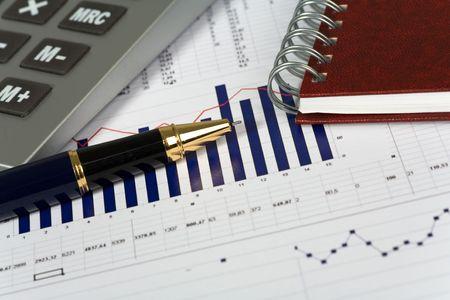 Financial concept. Calculator and pen. photo