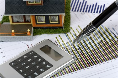 Model house and calculator on construction plan Stock Photo - 6435056