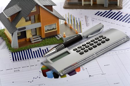 figuring: Model house and calculator on construction plan  Stock Photo
