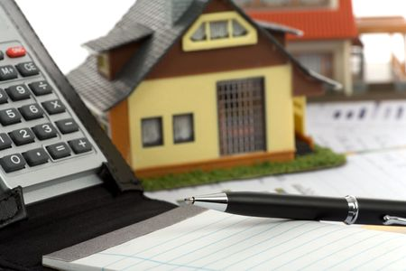 Model house and calculator on construction plan  Stock Photo - 6455839