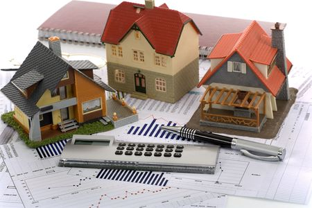 Model house and calculator on construction plan Stock Photo - 6455851