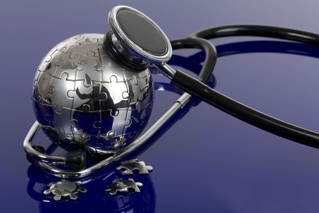Globe puzzle on blue background. Medical concept. Stock Photo