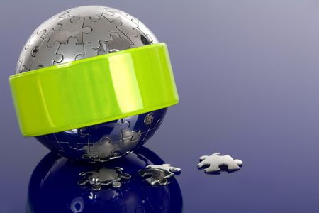 speculum: Globe puzzle with reflector on blue background.