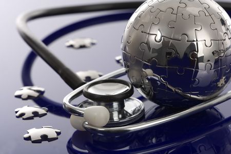 Globe puzzle on blue background. Medical concept. photo