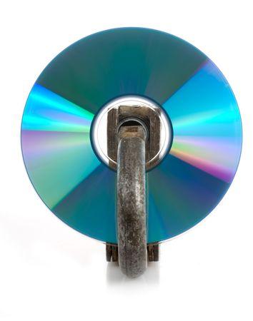 CD discs and padlock on white photo