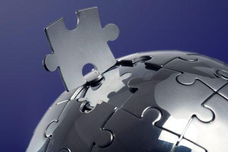 Globe puzzle on blue background