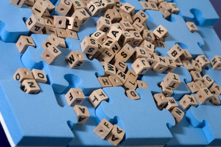 Blue puzzle with wood letter Stock Photo - 6667851