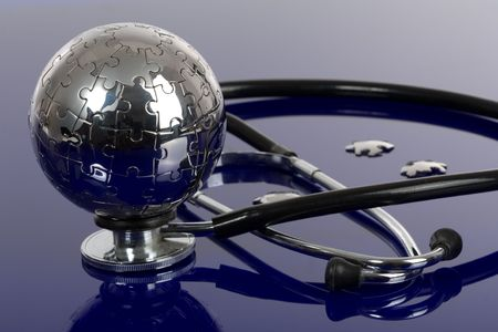 puzzles: Globe puzzle on blue background. Medical concept. Stock Photo