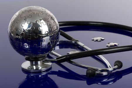 Globe puzzle on blue background. Medical concept. Stock Photo