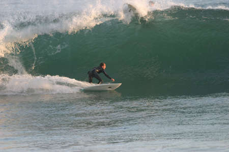 short wave: A west coast surfer turning into a large wave.