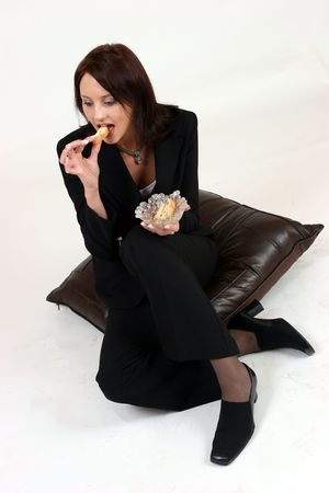 businesswoman sitting and eating Stock Photo