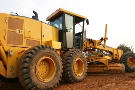 buildingsite: Grader road construction equipment Stock Photo