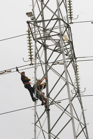 climbing cable: Workers climbing on power pylon