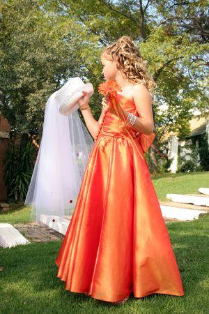 flowergirl: Flower girl at a wedding holding brides hat