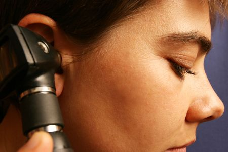 Medical equipment beeing used to check womans hearing