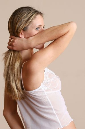 Woman holding her hair and stairing over her arm photo