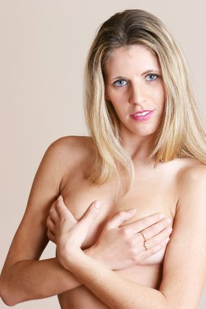 Woman covering her breast with her hands