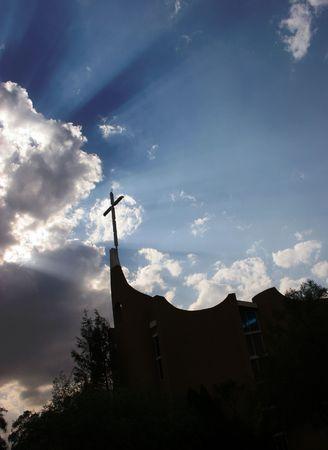 Sillouhette of Church with the sun shining Stock Photo