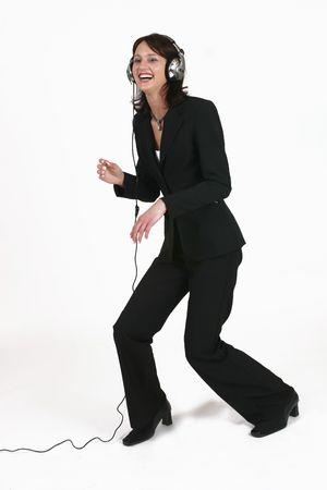 jive: Businesswoman listening to music