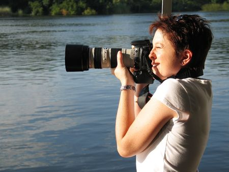 Woman taking a picture on a river