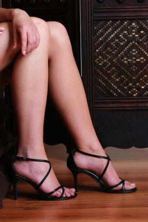 crossing legs: Woman crossing her legs