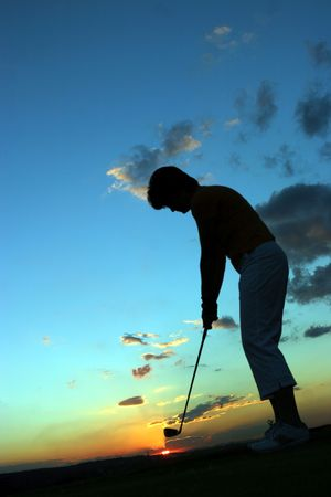 Silhouette of lady golfer