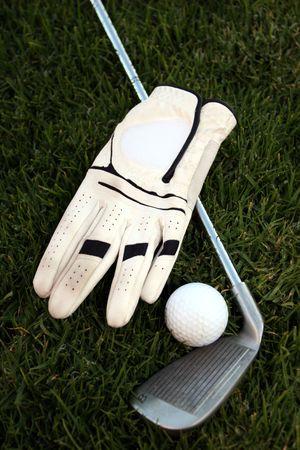 Golf kit : Ball, glove, club and green grass Stock Photo