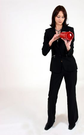 Businesswoman looking at fire extinguisher photo