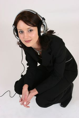 Businesswoman listening to music photo