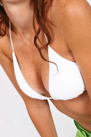 Woman standing in white bikini top Stock Photo - 294812