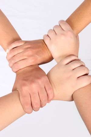 four hands: Interlocked hands of four people