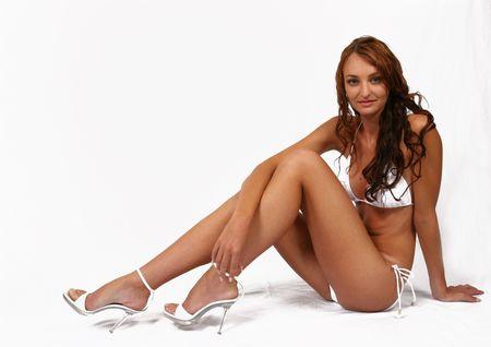 Woman sitting in bikini with shoes on Stock Photo - 294798