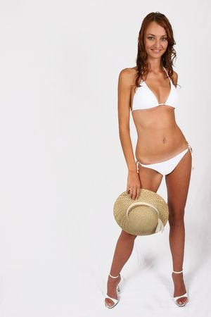 Woman standing in white bikini with shoes on Stock Photo - 298431