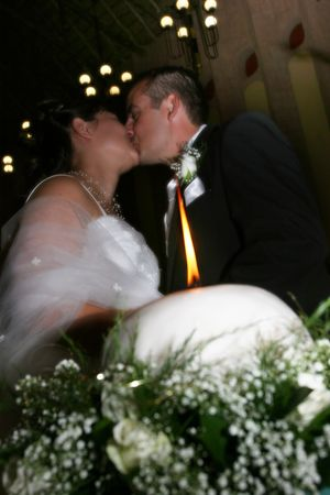 Groom giving his bride a kiss photo
