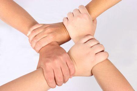 Interlocked hands of four people