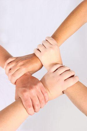 четыре человека: Interlocked hands of four people