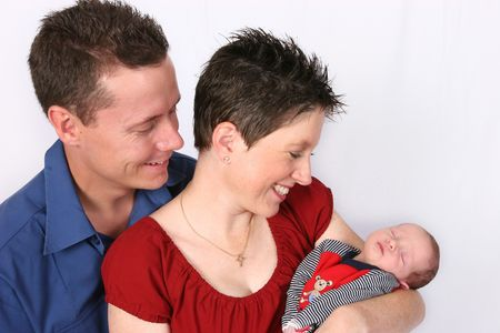 Couple with new born baby photo
