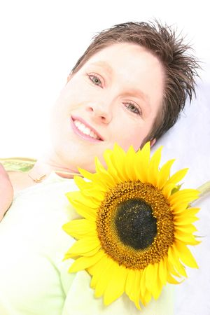 Close up of a womans face and a sunflower photo