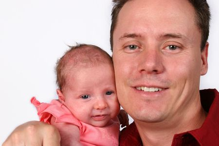 Young baby protected by her loving father Stock Photo