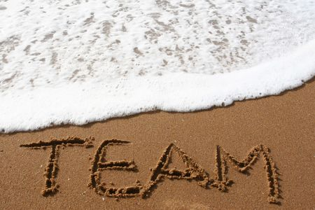 Word TEAM spelled in the sand on a beach Stock Photo
