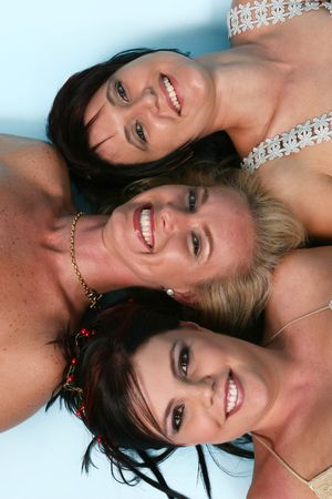 Three woman laying on the ground