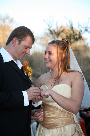 Young bride getting married to her husband Stock Photo - 439696