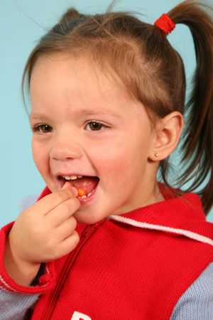 Young kid eating a sweet