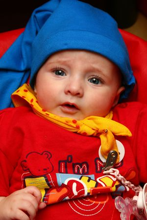 Baby with blue hat photo