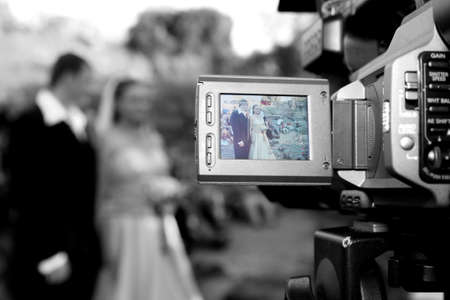 wedding being recorded with camera