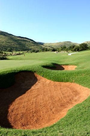 bunk: Sand bunk on golf course Stock Photo
