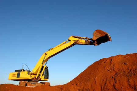 shifting: Heavy construction equipment digging ground on a hill Stock Photo