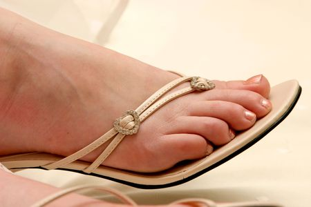 heel strap: Woman wearing a shoe with straps and silver decorations