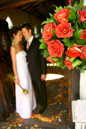 Hanging flower arrangement with bride and groom in background Stock Photo - 604807