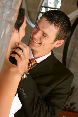 New husband smiling and touching his brides face